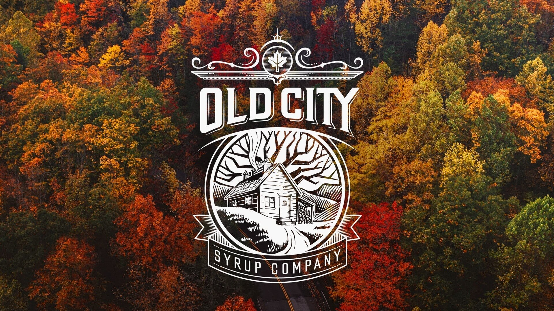 Old City Syrup Company Logo on top of colorful trees