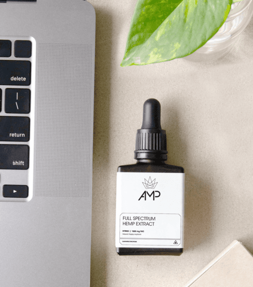 AMP Cannabis Tincture Packaging with laptop and leaf