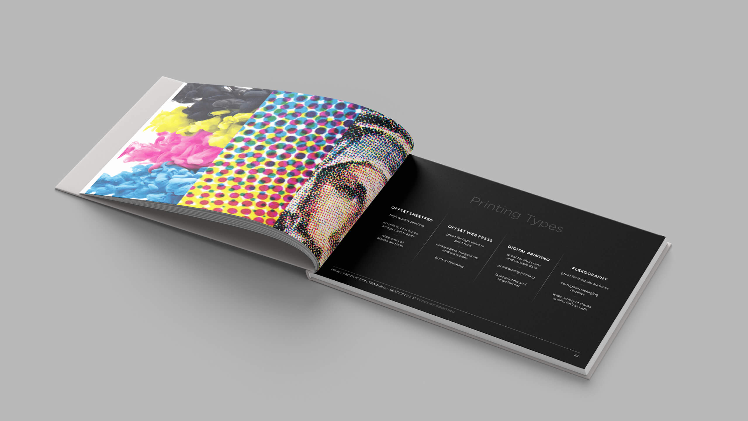 Spread from a Print Production Book Mockup on a grey surface