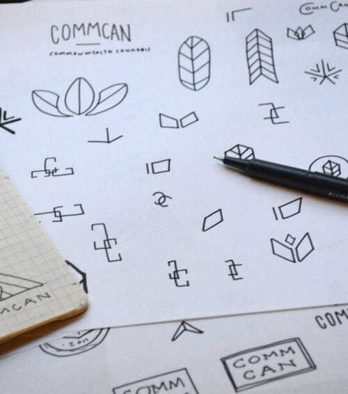 commcan cannabis logo sketching and process on table