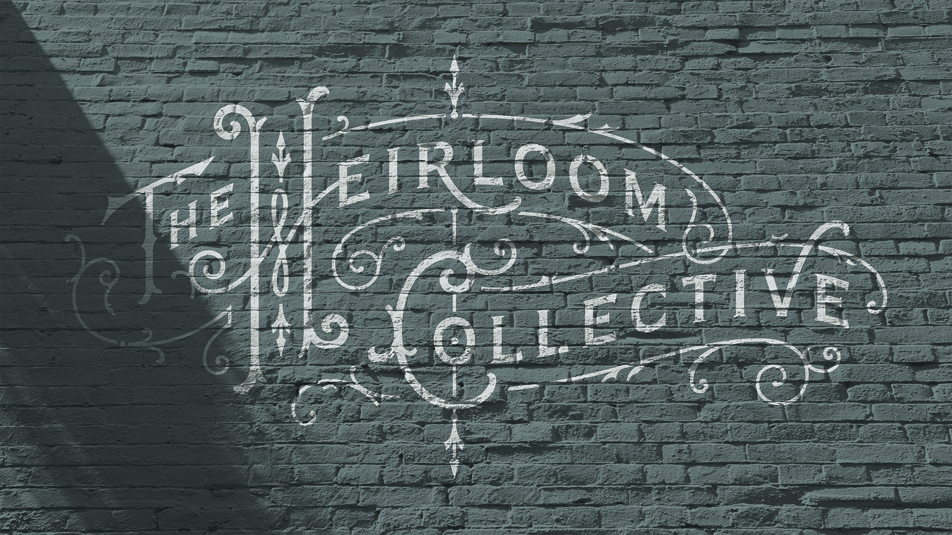 The Heirloom Collective Painted Logo Wall